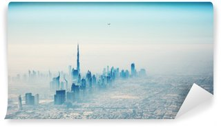 Fototapet av Vinyl Dubai stad i soluppgången Flygfoto