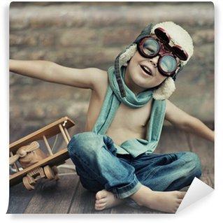 Fototapet av Vinyl En liten pojke spelar