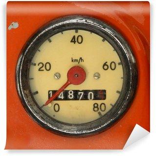 Fototapet av Vinyl Et Vintage Speedometer På En Red Scooter