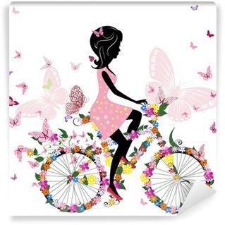 Fototapet av Vinyl Flicka på en cykel med en romantisk fjärilar