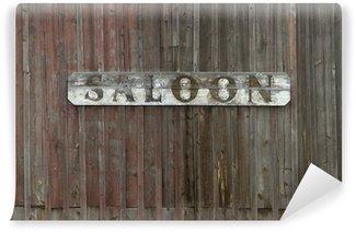 Fototapet av Vinyl Gamla Saloon tecknar på Weathered Wood Wall