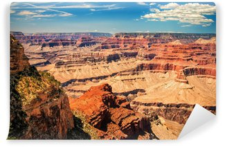 Fototapet av Vinyl Grand Canyon solig dag med blå himmel