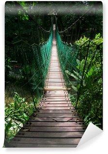 Fototapet av Vinyl Hängbro i den tropiska djungeln