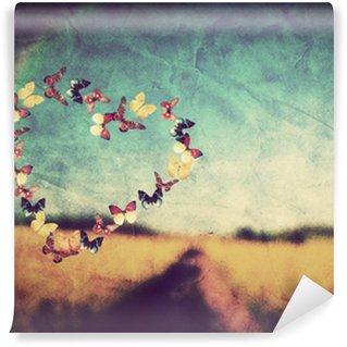 Fototapet av Vinyl Hjärta formar gjort av fjärilar på vintage fält bakgrund