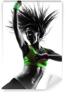 Fototapet av Vinyl Kvinna utövar fitness zumba dans silhuett