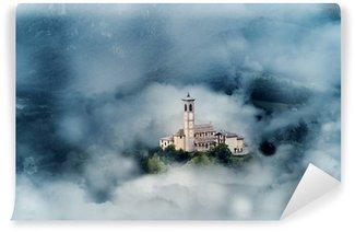 Fototapet av Vinyl Kyrka mellan moln