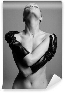 Fototapet av Vinyl Naken eleganta flickan med handskarna. Studio mode foto.