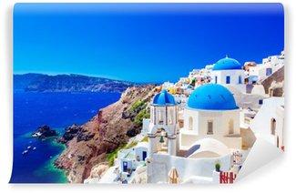 Fototapet av Vinyl Oia stad på ön Santorini, Grekland. Caldera på Egeiska havet.