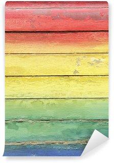 Fototapet av Vinyl Regnbågens färger målade på Weathered Wood
