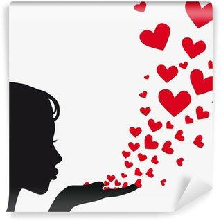 Fototapet av Vinyl Silhouette kvinna blåser hjärta