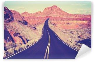 Fototapet av Vinyl Tappning tonad böjda öken motorväg, resekoncept, USA