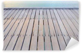 Fototapet av Vinyl Wood bridge på stranden