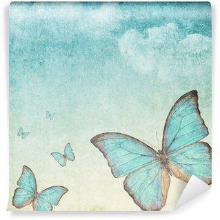 Fototapeta Vinylowa Archiwalne tła z niebieskim motylem