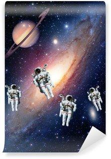 Vinylová Fototapeta Astronauti kosmonaut ve vesmíru sluneční soustavy Saturn planety vesmíru. Prvky tohoto obrázku zařízeném NASA.