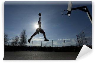 Vinylová Fototapeta Basketbalový hráč silueta ve vzduchu asi slam dunk