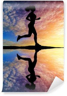 Vinylová Fototapeta Běh dívka při západu slunce silueta