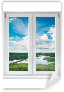 Fototapeta Winylowa Biały plastik podwójne drzwi okno z widokiem na spokojny krajobraz