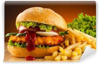 Fototapeta Winylowa Big hamburger, frytki i warzywa