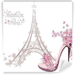 Fototapeta Winylowa Buty na wysokim obcasie na tle wieży Eiffla. Paris Fashion