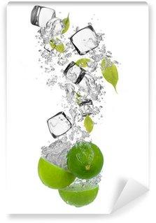 Vinylová Fototapeta Čerstvé citrusy, které spadají do stříkající vodě