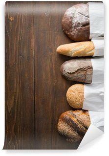 Vinylová Fototapeta Čerstvý chléb upečený na dřevěný stůl