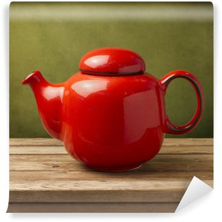 Vinylová Fototapeta Červený čaj hrnec na dřevěném stole přes zelené grunge zeď