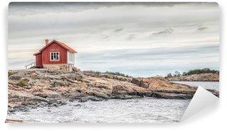 Vinylová Fototapeta Červený dům na břehu moře v matných barvách na podzim