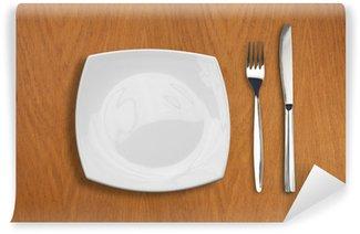 Vinylová Fototapeta Čtvercový bílý talíř, nůž a vidlička na dřevěný stůl