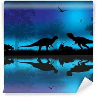 Fototapeta Winylowa Dinozaury sylwetki na niebieskim nocy