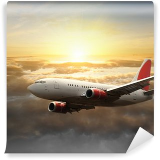 Fototapeta Winylowa Duży samolot o zachodzie słońca