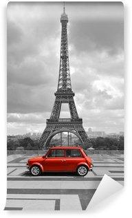 Vinylová Fototapeta Eiffelova věž s autem. Černobílá fotografie s červeným prvkem.