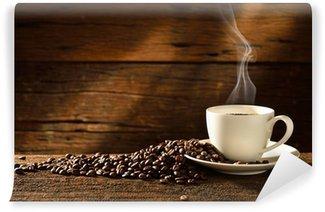 Fototapeta Vinylowa Filiżanka kawy i ziarna kawy na starym drewnianym tle