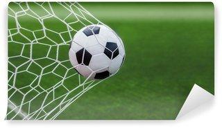 Vinylová Fototapeta Fotbalový míč v cíli se zeleným doprovodných