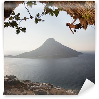 Vinylová Fototapeta Horolezec na útesu. Kalymnos Island, Řecko.
