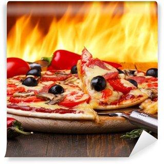 Fototapeta Winylowa Hot pizza z pieca na tle pożaru