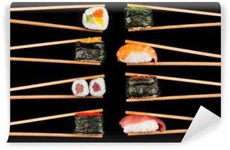 Fototapeta Vinylowa Kawałki sushi w pałeczkami