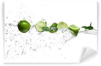 Vinylová Fototapeta Kousky citrusy v stříkající vodě