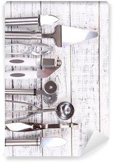 Vinylová Fototapeta Kovové kuchyňské nádobí na stůl close-up