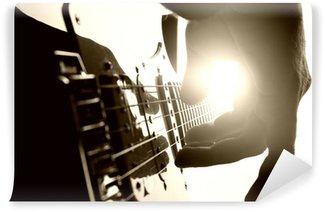 Vinylová Fototapeta Kytarista hraje na jevišti. Detailní pohled