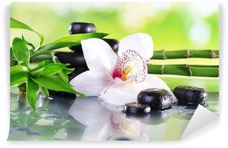 Vinylová Fototapeta Lázeňské kameny, bambusové větve a bílá orchidej
