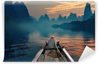 Vinylová Fototapeta Loď jízda v řece při západu slunce vedle krásné hoře