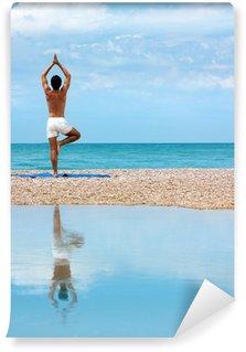Fototapeta Vinylowa Man Doing Yoga. Vrikshasana Pose (drzewa)