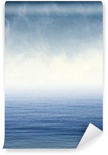 Vinylová Fototapeta Mlha na modrém oceánu. Mlha a mraky vznášející se nad Tichým oceánem. Obrázek zobrazuje příjemný papíru obilí a textury na 100%.