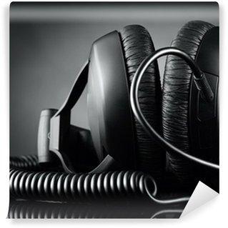 Vinylová Fototapeta Moderní sluchátka přes tmavé pozadí