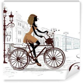 Vinylová Fototapeta Módní holka jezdí na kole, zdobené hudební holi