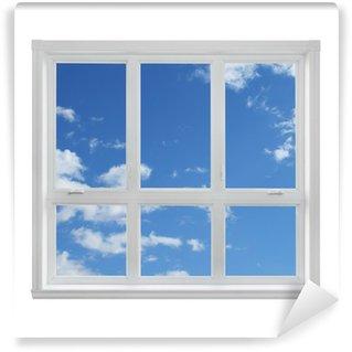 Fototapeta Vinylowa Niebieskie niebo widziane przez okno