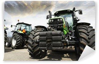 Vinylová Fototapeta Obří traktory nastavit proti západu slunce na obloze a mraky