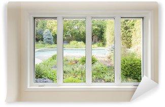 Fototapeta Winylowa Okno z widokiem na letnim ogródku
