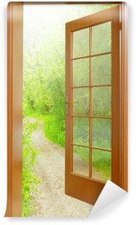 Vinylová Fototapeta Otevřel dveře do ranních hodin v zelené zahradě.