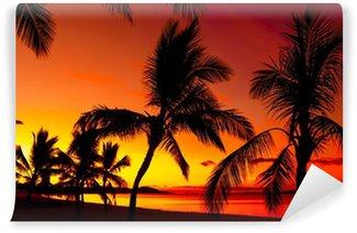 Vinylová Fototapeta Palmy siluety na tropické pláži při západu slunce